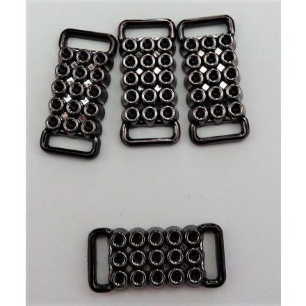Fém hatású műanyag ruhadísz 24x10 mm.