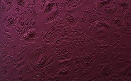 150cm széles, rugalmas buklé anyag, bordó színben.