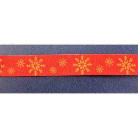 Piros alapon arany hópehely mintás grosgrain szalag, 20 mm széles.