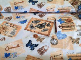 Rózsaszín alapon türkiz baglyos mintás pamutvászon textil.