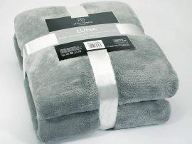 Pléd - takaró 150x200 cm méretben bézs mintás.